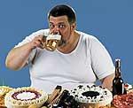 Dicker Mann mt Bierglas und Kuchen
